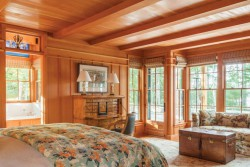 Arts and crafts style master bedroom in home on Littlejohn Island, ME featuring floral Pine Cone Hill duvet cover from Dwellings in Falmouth