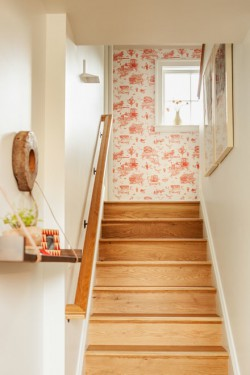 Fans of the Beastie Boys, designer Krista Stokes and Geoff Bowley chose a toile wallpaper from Mike D in collaboration with Favor Paper (used in the rapper's Brooklyn brownstone) for the 2nd floor landing