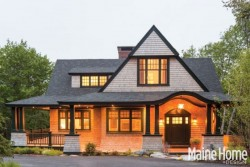 Evening view of shingle-style home