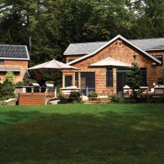 Sundog Solar of Searsport added solar panels to the barn roof to increase the energy efficiency of all the property's structures. The cedar shingles of the barn and house were sandblasted and stained with urethane to keep them bright.