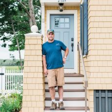 Home builder Jonathan Trudo on the front steps of one of his latest projects, a rental cottage across the road from Goose Rocks Beach in Kennebunkport that he built for longtime clients.