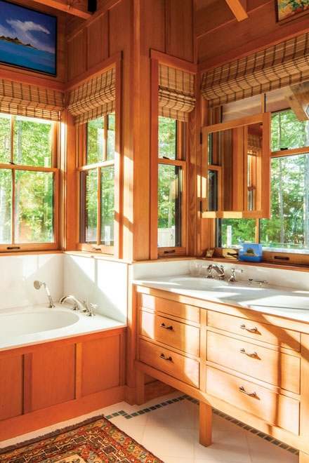 Master bathroom in home on Littlejohn Island, ME featuring Thassos marble on the vanity top, floor tile and tub surround