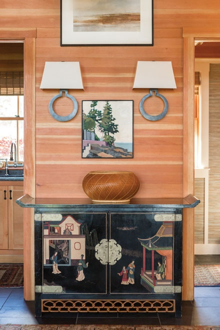 In the foyer, a 1960s Chinese cabinet from Pillars displays a bamboo basket the owners bought in Japan