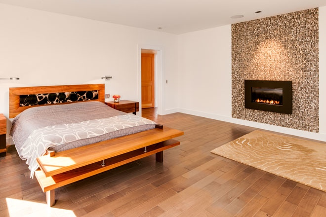 the master bedroom features a custom bed designed by phi home designs and garth smith the headboard contains petrified wood tiles - Phi Home Designs