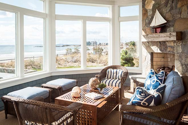 An octagonal screened porch with views of Kennebunk s Gooch s Beach  The  fireplace is made from stone similar to that employed at the nearby  Franciscan  Family Heirloom in Kennebunk   Maine Home   Design. Porch Dining Room Kennebunkport. Home Design Ideas