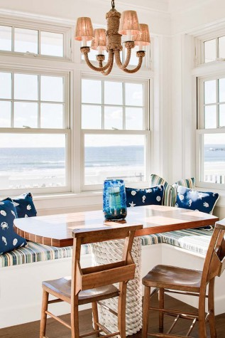 The kitchen table and banquette are reminiscent of an upscale galley kitchen   The top of the table is teak and holly  the base is wrapped in rope Family Heirloom in Kennebunk   Maine Home   Design. Porch Dining Room Kennebunkport. Home Design Ideas