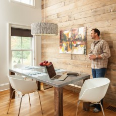 When building his own home, Geoff Bowley of Bowley Builders took inspiration from farmhouses and barns. In the dining area, a reclaimed wood accent wall provides warmth