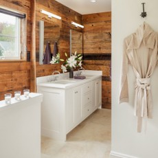 Wood is featured in the owners' bath, contrastingwith clean white custom cabinetry by Derek Preble Cabinetmakers