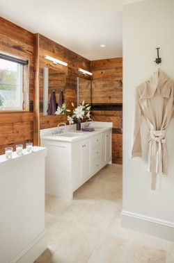 Wood is featured in the owners' bath, contrasting with clean white custom cabinetry by Derek Preble Cabinetmakers