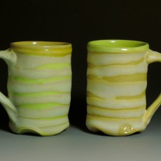Twin Cups, porcelain, from 2015, measuring 4.75 x 4 x 3 inches each, by Marian Baker