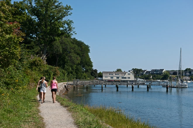 In York, a foursome enjoys a summer walk along the water