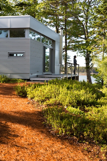Enters the house via a deck that Rockport Steel built using fiberglass decking, aluminum posts and floor joists, cable railing, anda teak cap. The deck is a custom add-on to the basic modular design from Rocio Romero