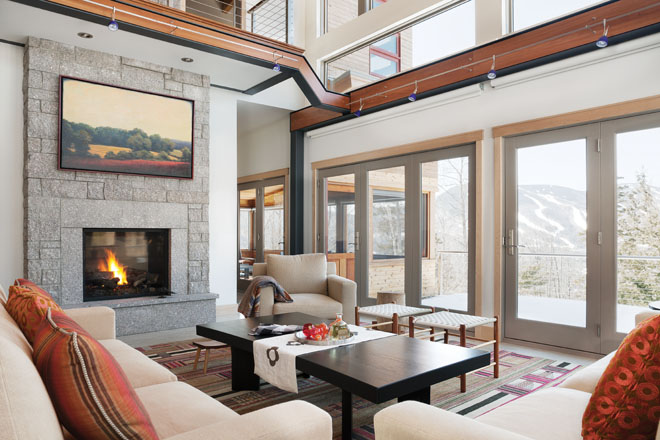 the houses open floor plan and linear style called for an interior design that would not compete with the lines of the house and the views beyond - Maine Home Design