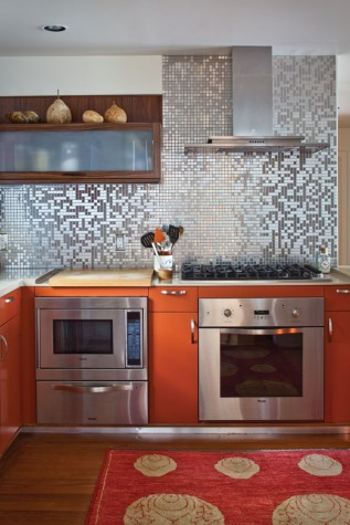 phi home designs of rockport designed and built this sleek kitchen of stainless steel tiles and european cabinetry the cabinets below are a pumpkin colored - Phi Home Designs