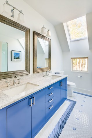 the floor is finished with playful penny round tiles the blue of the custom vanity left by phi home design is - Phi Home Designs