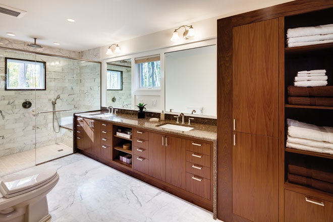 the owners bathroom with custom cabinetry by phi home designs the dark wood complements the mahogany furniture in the owners bedroom - Phi Home Designs