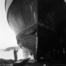 Skipper in Port Clyde, Maine, black and white photography by Antonia Small, 2013, film negative, measuring 2.25 x 2.25 inches