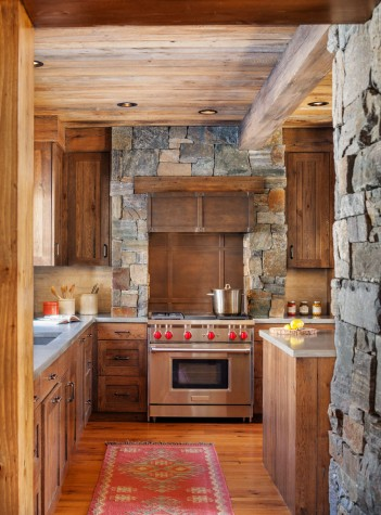 The Same Stone That Is Featured On The Homeu0027s Exterior And Fireplaces Is  Used In The Kitchen, Both Around The Stove And In The Form Of Two Columns  That ...