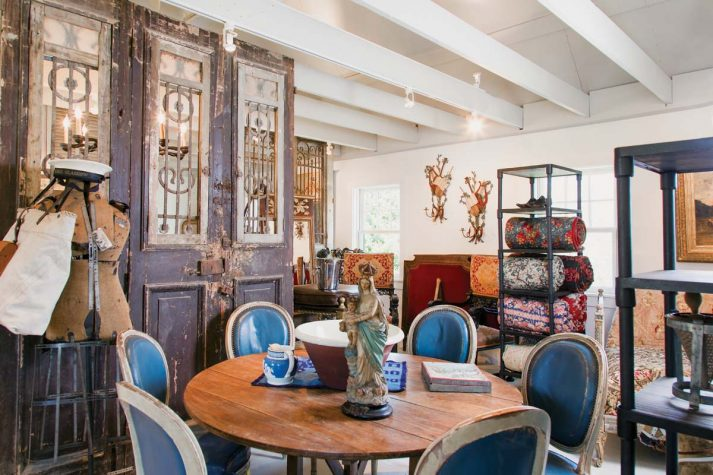 upstairs triple panel entry doors from the 1800s set the backdrop for a walnut table leather louis xvi dining chairs and a late 1800searly 1900s cast - 1900s Home Design