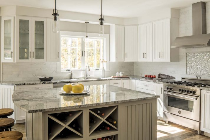 The kitchen cabinets are configured in a L-shape that surround an island topped with vividly veined Silver Cloud granite. This final eye-catching look was ... & Just Across the River - Maine Home + Design kurilladesign.com