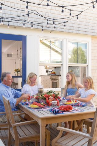 the seaver family enjoys a lobster dinner on the ip deck that serves as bridge between their higgins beach propertys front and back cottages