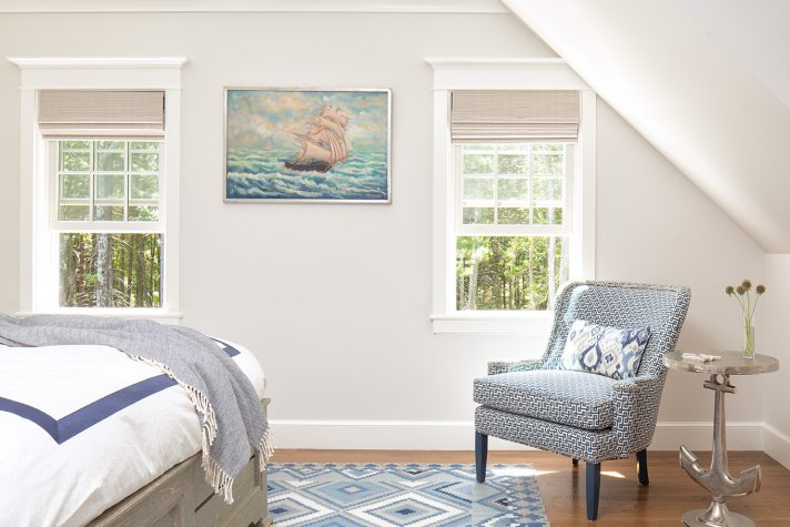 Navy blue and nautical themes in a bedroom designed by Louise Hurlbutt