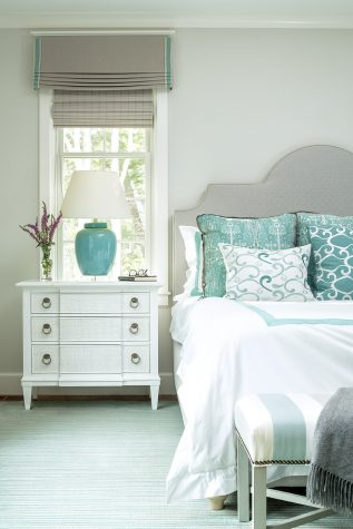 Sea foam greens set off by cool gray dominate the owners' bedroom designed by Louise Hurlbutt
