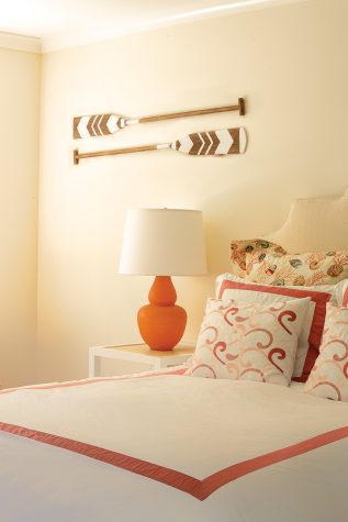 This bedroom's coral color scheme is reminiscent of the Tides Beach Club in Kennebunkport designed by Louise Hurlbutt