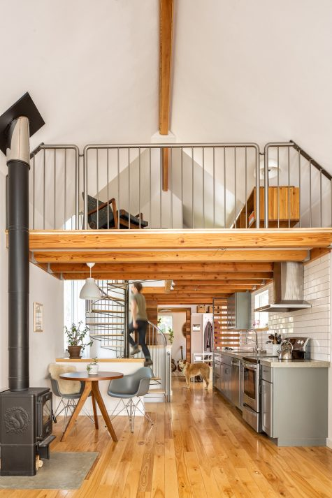 Architect Alex Lehnen ascends a spiral stair fabricated by Tunnelwerks International in Portland; the original house ended just behind it.