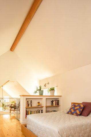 A bookcase creates a sense of privacy for the De La Espada bed at the back of the house.