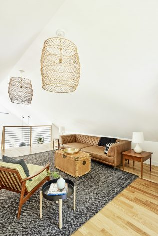 The loft living space populated with light, airy furnishings