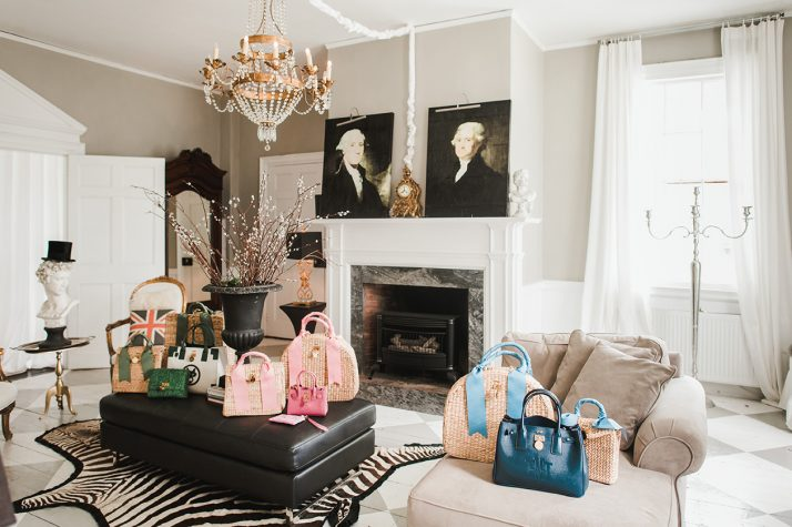 A variety of MME.MINK handbags are strewn throughout Haedrich's