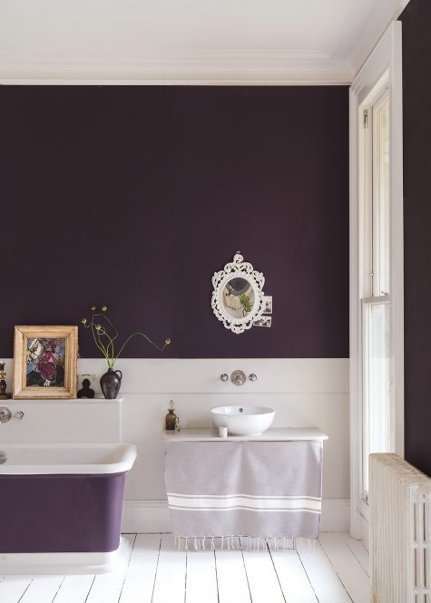 This elegant bathroom takes a turn for the dramatic with walls (and a soaking tub) painted in Farrow and Ball's Paean Black. (Plum)